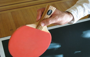 Modern way of holding a paddle